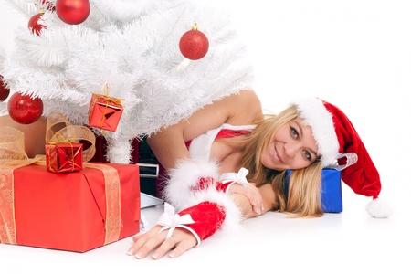 christmas woman lying on floor among gift Stock Photo - 10414821