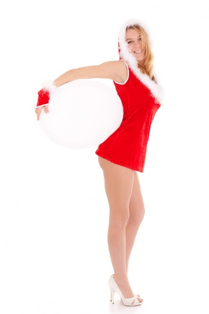 ass standing: sexy christmas woman showing blank oval advert isolated on white
