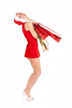 sexy young woman in santa suit carrying shopping bags Stock Photo - 10414837