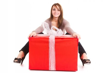 young woman receiving big gift isolated on white photo