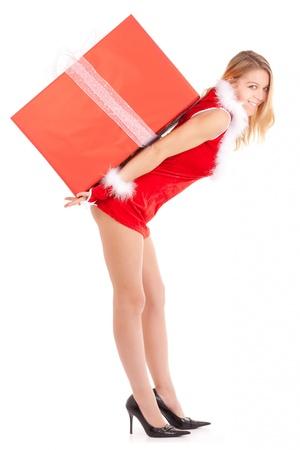 falda corta: mujer de Navidad llevando gran regalo en espalda Foto de archivo