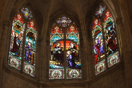 "passion of the christ: detail of french gothic church ""notre dame dUzeste"" with 19th century stained glasses, France"