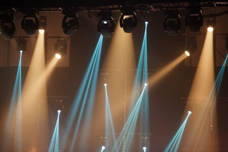 blue and golden stage spotlights for music concert photo