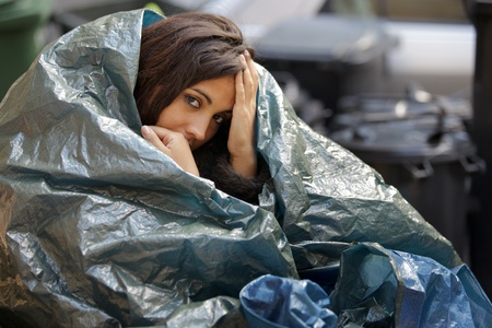 poor young woman wrapped in plastic tarpaulin photo