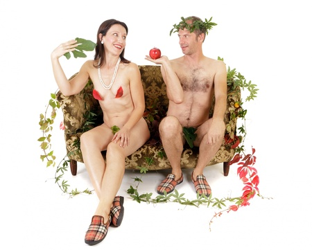 nude couple sitting on couch adam and eve concept Stock Photo