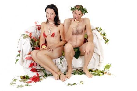 surprised naked kitsch couple sitting on couch photo