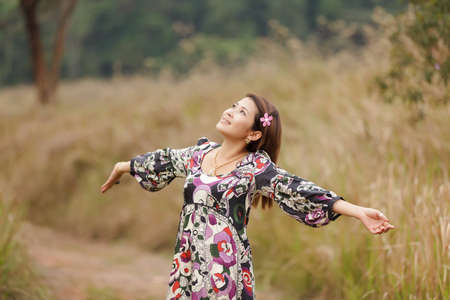 woman breathing in wild nature park, thailand photo