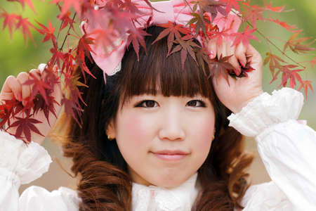 lolita: japanese lolita portrait in park during fall season, Tokyo Stock Photo