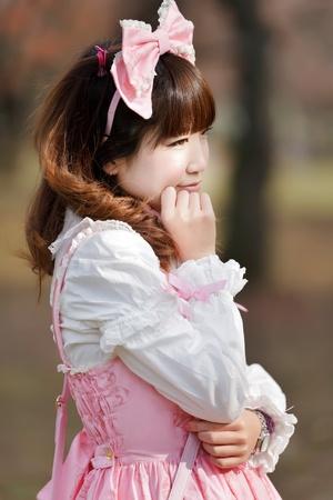 lolita: japanese in sweet lolita cosplay outdoor portrait