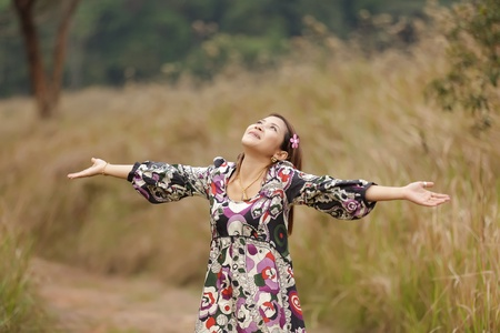 happy asian woman breathing in nature, thailand photo