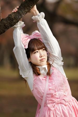 lolita: japanese lolita portrait in park during fall season, Tokyo Stock Photo
