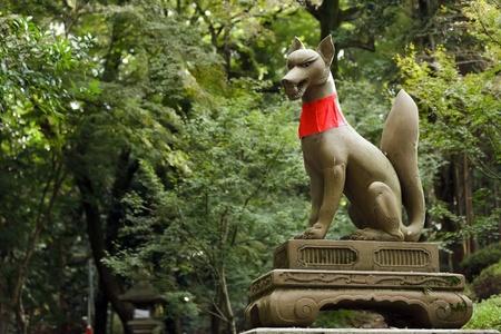 messengers of god: god fox statue in fushimi inari shrine near Kyoto, Japan