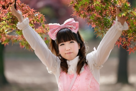 japanese lolita fashion in park during fall season, Tokyo photo