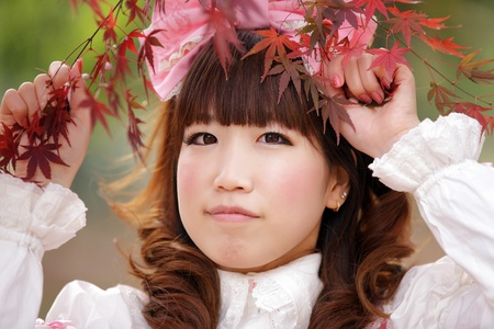 japanese lolita portrait in  fall season, Tokyo photo