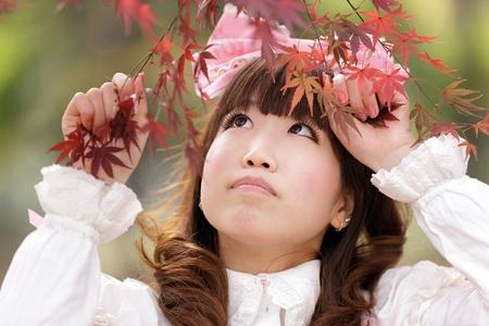 lolita: japanese lolita portrait in  fall season, Tokyo Stock Photo