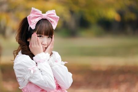 lolita: japanese in sweet lolita cosplay in harajuku park, Tokyo