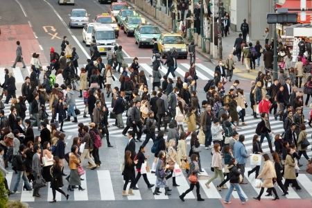 TOKYO - NOVEMBER 25: People crossing street at Hachiko crossroad in Shibuya district on November 25, 2011 in Tokyo, Japan.