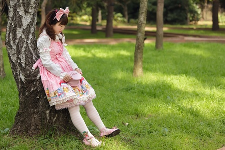 sad japanese woman in sweet lolita cosplay, Tokyo photo