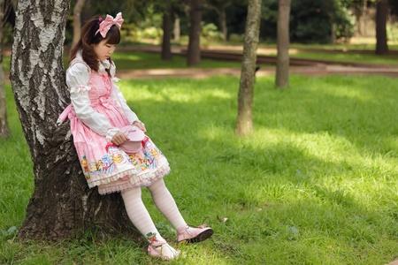 sad japanese woman in sweet lolita cosplay, Tokyo photo