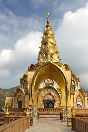 golden buddhist temple with ceramic, wat Phasornkaew, Thailand photo