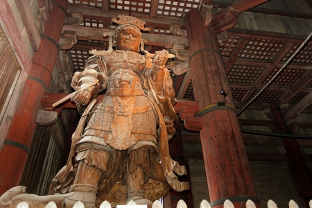 todaiji: Koumokuten demon wooden giant statue in Todaiji temple, Nara, Japan Editorial