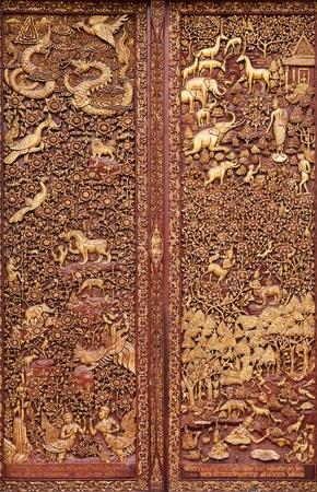 wood carving door: wooden carving in buddhist temple door, Thailand Stock Photo
