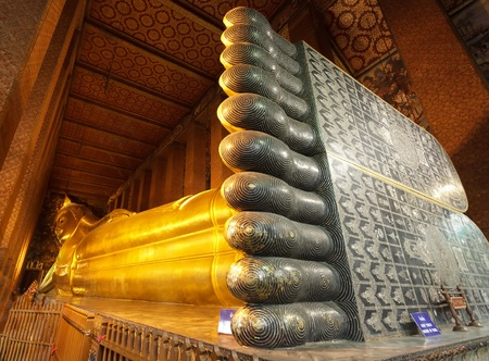 golden reclining giant buddha in wat pho temple, Bangkok, Thailand