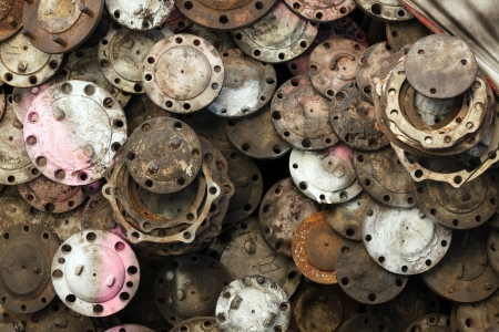 stack of rusted metallic car parts in garage photo