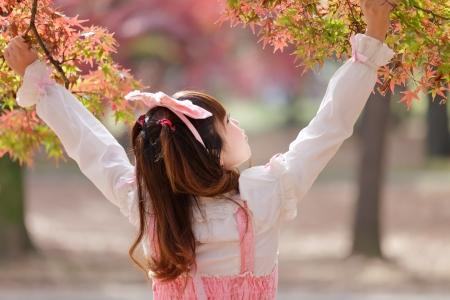 lolita: japanese girl in lolita cosplay fashion in park Stock Photo