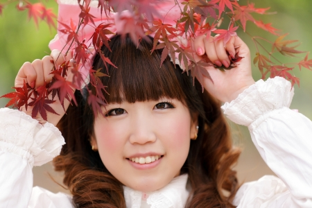japanese lolita portrait in park during fall season, Tokyo photo