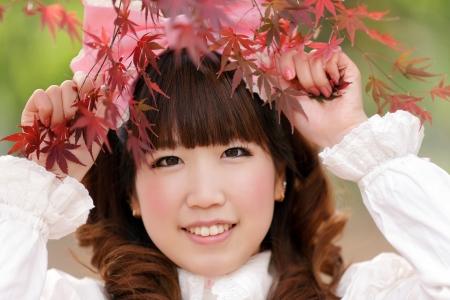 japanese lolita portrait in park during fall season, Tokyo photo