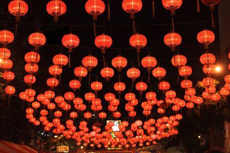 street lamps: illuminated chinese lanterns hanging in bangkok street for new year celebrating