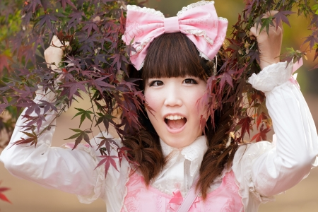japanese girl in lolita cosplay fashion in park photo