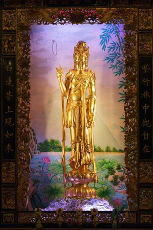 golden statue of Guan Yin goddess in Bangkok chinatown temple, Thailand