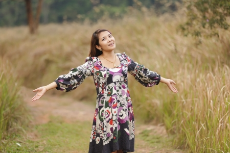 woman breathing in wild nature scenery, thailand photo