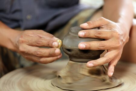 closeup on potter man hands shaping ceramic craft, ko kret island, Thailand