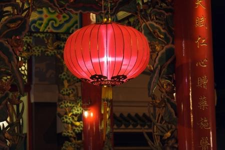 illuminated chinese lantern hanging in buddhist temple