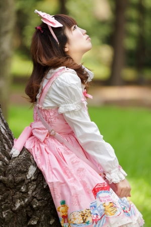 japanese woman in sweet lolita cosplay in harakuju park, Tokyo photo