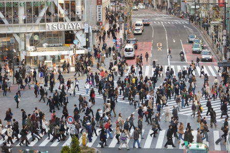 TOKYO - NOVEMBER 25: People crossing street at Hachiko crossroad in Shibuya district on November 25, 2011 in Tokyo, Japan. Editorial