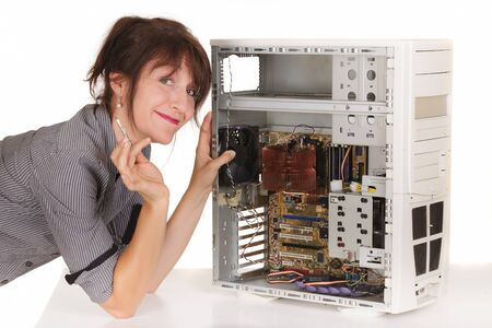 woman using tweezers to repair computer photo