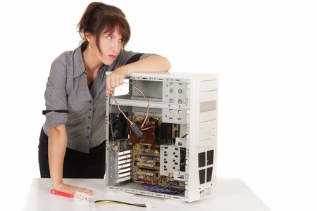 bored woman repairing computer photo
