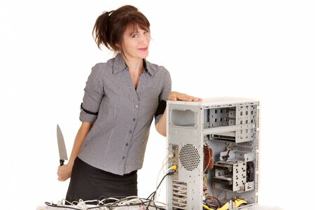 business woman going to kill her desk computer photo