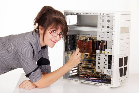 woman trying to repair computer with tweezers photo