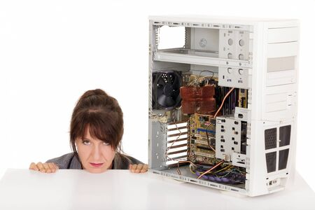technophobe: frustrated woman and broken computer