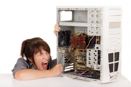 woman in furious crisis with broken computer photo