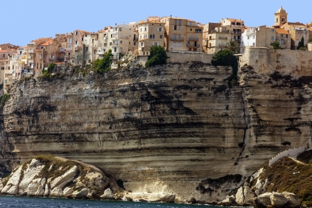 Bonifacio ancient city on limestone cliff, Corsica island, France photo