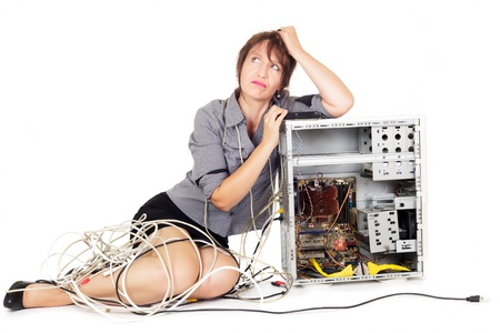 repair computer: worried woman thinking to find solution to repair computer Stock Photo