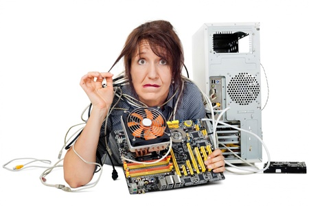 confused and grimacing woman shown computer motherboard