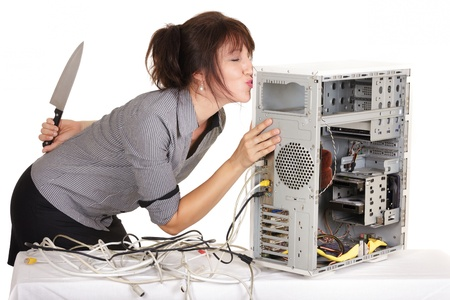 business woman kissing computer before murdering it photo