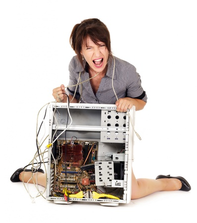 rage: displeased woman yelling on broken computer